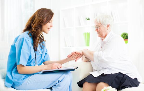 Apotheco psoriasis - Patient holding elderly woman's hands