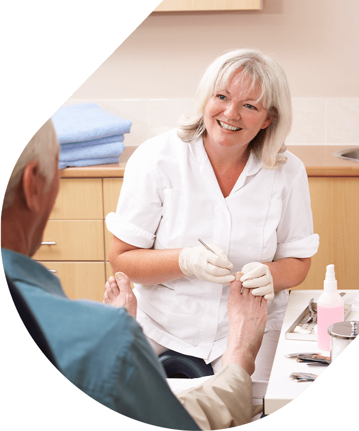 Apotheco Fungal Infections - Doctor examining patient's foot smiling at patient